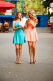 Two girlfriends eating cotton candy. Summer activities Royalty Free Stock Image