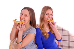 Two girlfriends eating pizza Royalty Free Stock Images
