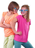 Two girlfriends friends wearing eyeglasses isolated over white Royalty Free Stock Photo