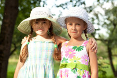 Two girlfriends in hats Stock Image