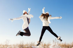 Two girlfriends have fun and enjoy fresh snow Stock Image