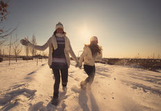Two girlfriends have fun and enjoy fresh snow Royalty Free Stock Images