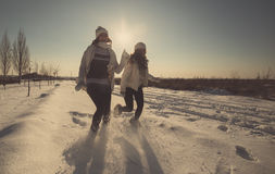 Two girlfriends have fun at winter day Royalty Free Stock Images