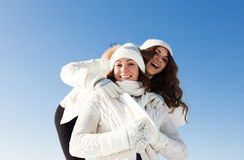 Two girlfriends have fun at winter day Royalty Free Stock Image