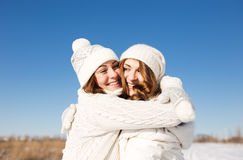 Two girlfriends have fun at winter day Stock Photography