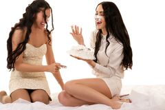 Two girlfriends having fun with a cake Royalty Free Stock Photos