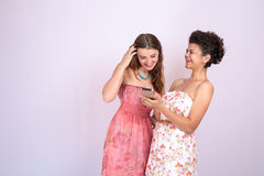 Two girlfriends having fun on the Internet. Technology, Internet , communication Royalty Free Stock Photos