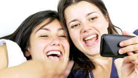 Two girlfriends having fun looking cell phone. Happy women having fun with cell phone stock video