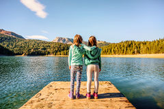 Two girlfriends hugging and admiring the Black Lake in Durmitor Stock Image