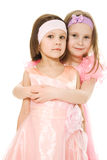 Two girlfriends hugging dresses in pink Stock Images