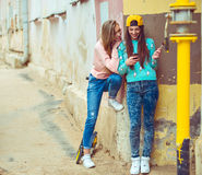 Two girlfriends are hugging and having fun Royalty Free Stock Photo