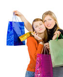 Two girlfriends hugging having made a shopping run royalty free stock photos