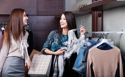 Friends are joking while do shopping Stock Image