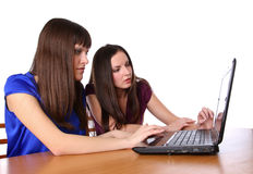 Two girlfriends looking at laptop Royalty Free Stock Photography