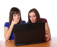 Two girlfriends looking at laptop Royalty Free Stock Photos