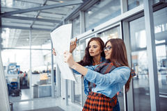 Two girlfriends looking for a route map.Art processing and retou. Ching photos special Stock Photography