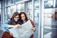 Two girlfriends looking for a route map.Art processing and retou. Ching photos special Stock Photo