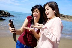 Two girlfriends looking at selfie they have done unhappy stock photos