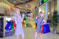 Two girlfriends at the mall with shopping bags Royalty Free Stock Images