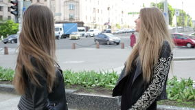 Two girlfriends meeting in the city. Center, laughing and smiling stock footage