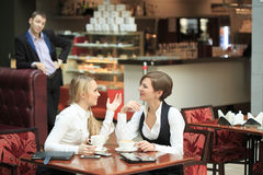 Two girlfriends office staff. in cafe on a Royalty Free Stock Image