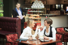 Two girlfriends office staff. in cafe on a Stock Images