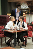 Two girlfriends office staff. in cafe on a Royalty Free Stock Photo