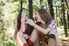 Two girlfriends outdoor laughing Royalty Free Stock Image