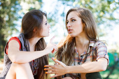Two girlfriends outdoor talking Stock Photos