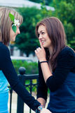 Two girlfriends outdoors Royalty Free Stock Photos