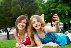 Two girlfriends in park Royalty Free Stock Images