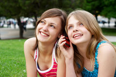 Two girlfriends in park Stock Images