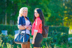 Two girlfriends in park Stock Image
