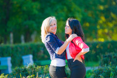 Two girlfriends in park Royalty Free Stock Image