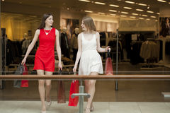 Two girlfriends on shopping walk on shopping mall with bags Royalty Free Stock Photography
