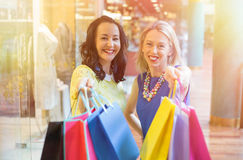 Two girlfriends showing their shopping bags Royalty Free Stock Images