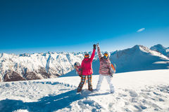 Two girlfriends snowboarders in the alpine mountains. Stock Images