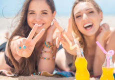 Two girlfriends on the summer beach Royalty Free Stock Image