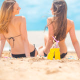 Two girlfriends on the summer beach Royalty Free Stock Photography