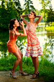 Two girlfriends on summer vacations Stock Image