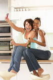 Two Girlfriends Taking Photo With Digital Camera Royalty Free Stock Photo