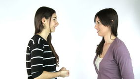 Two girlfriends talking in studio isolated stock video footage