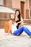 Two girlfriends traveling Stock Photography