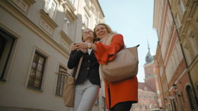 Two Girlfriends are Walking around the City, Laughing and Hugging in Slow Motion stock video footage