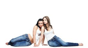 Two girlfriends wearing blue jeans Royalty Free Stock Image