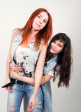 Two girlfriends were offended, turned their backs to each other. different emotions. looking away after conflict at home Stock Photography