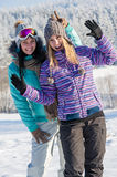 Two girlfriends in winter snow mountains smiling Stock Photography