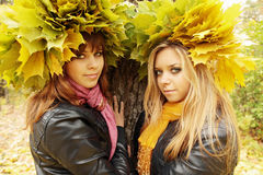 Two girlfriends in wreaths Royalty Free Stock Images