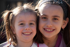 Two Girls. Adorable sisters having fun and smiling outdoor Royalty Free Stock Photography