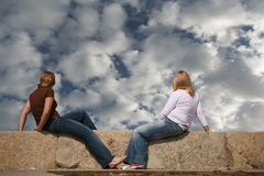 Two girls. Looking the sky Stock Images